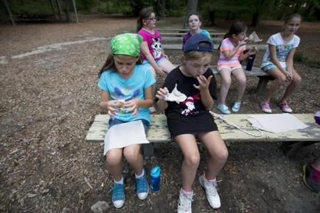 At Camp Wind-in-the-Pines, Girl Scouts often make s'mores as a treat at the overnight camp, but especially on Sunday nights, hours after the girls are dropped off.